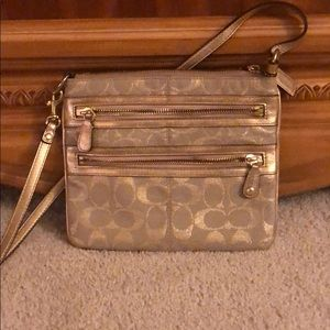 Gold coach crossbody with gold leather strap